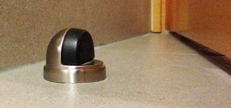 Safe magnetic door holder