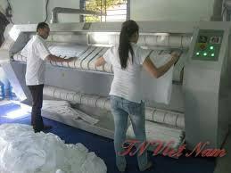 Quy trình giặt là công nghiệp sử dụng hóa chất giặt là