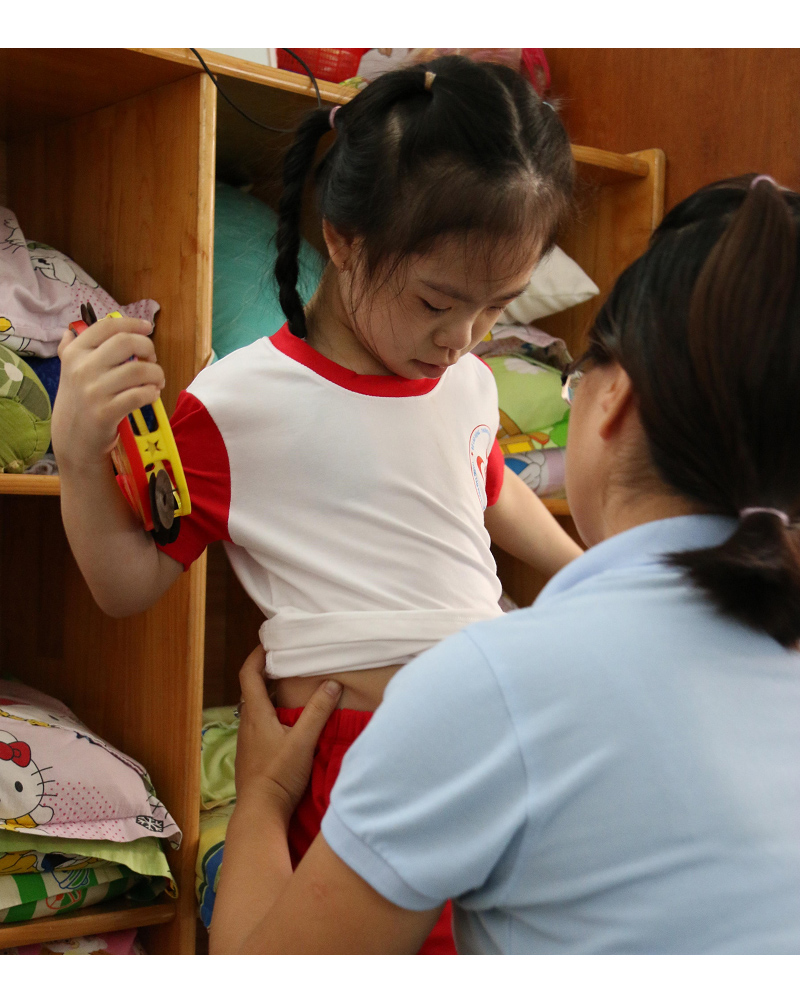 UGETHER PROVIDE UNIFORMS FOR THE CHILDREN AND TEACHERS AT CENTER OF REHABILITATION AND ASSISTANCE FOR DISABLED CHILDREN HO CHI MINH CITY.