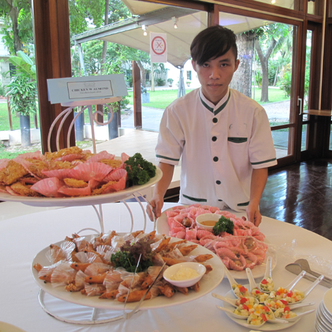 student preparing a catering event