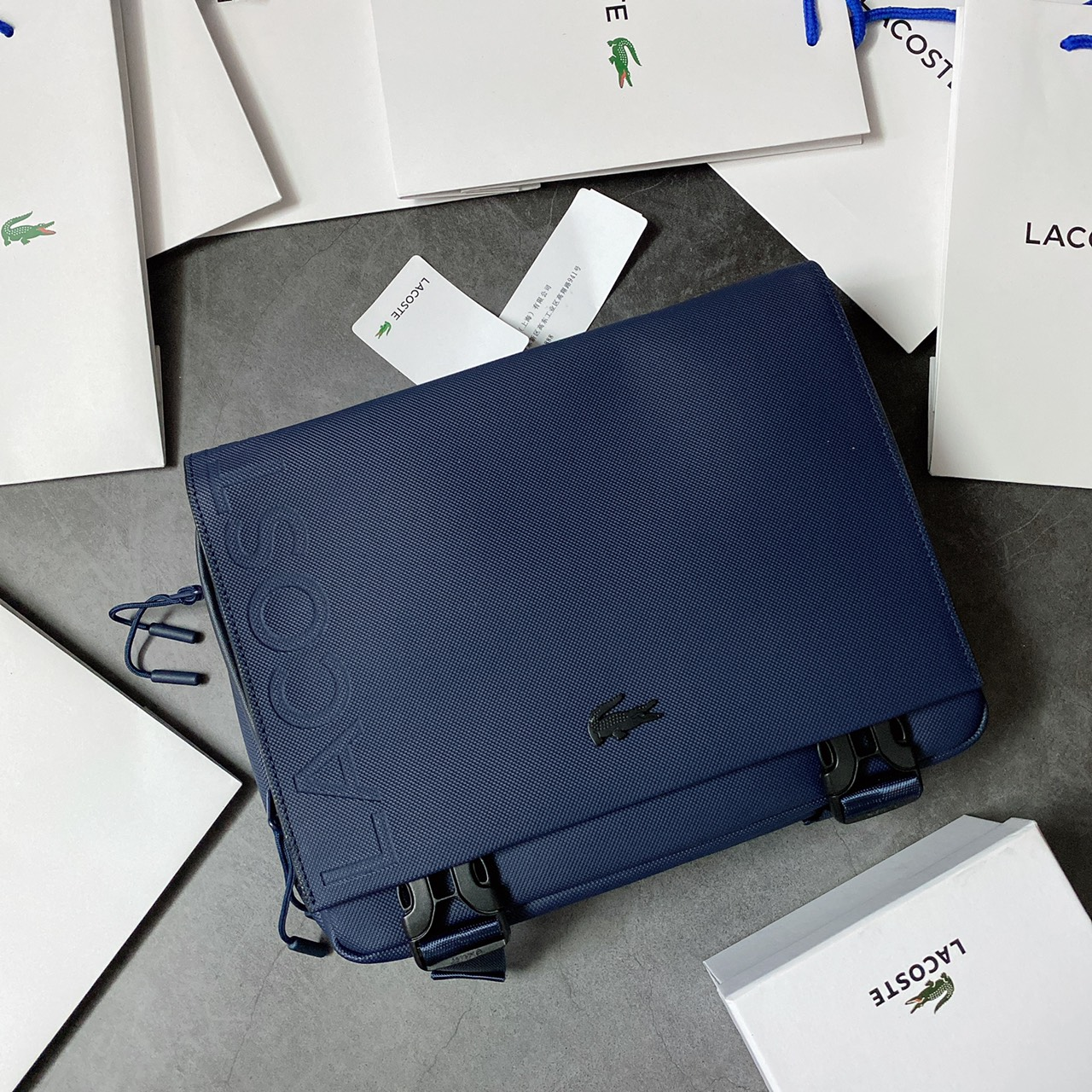 Túi Lacoste office nắp gập logo dọc - XK820