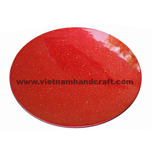 Red lacquered decor plate with hand-painted gold dots