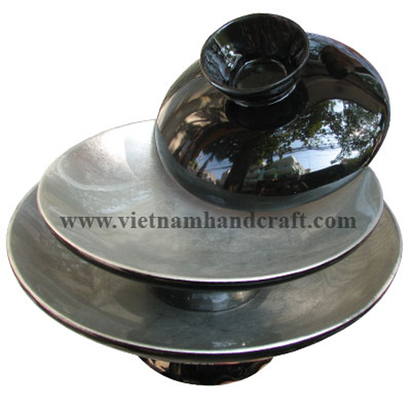 Lacquer bowl. Inside in white silver leaf, outside in black