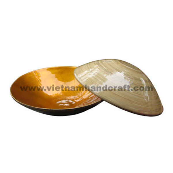 Lacquered bamboo decoration bowl. Inside in dark gold silver leaf, outside in natural bamboo