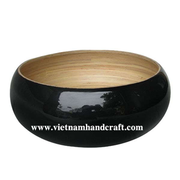 Lacquered bamboo fruit bowl. Inside in natural bamboo, outside in black