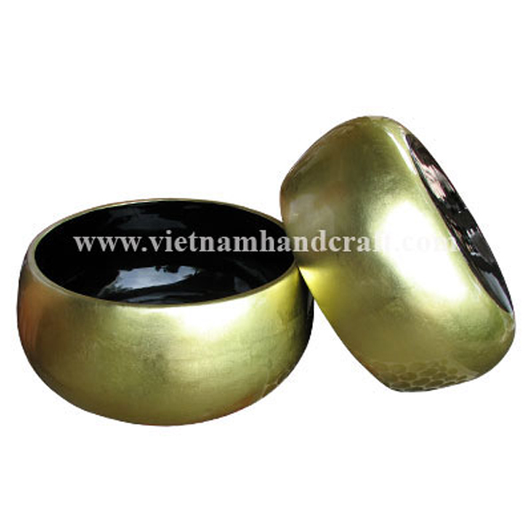 Lacquered fruit bowl. Inside in black, outside in gold silver leaf