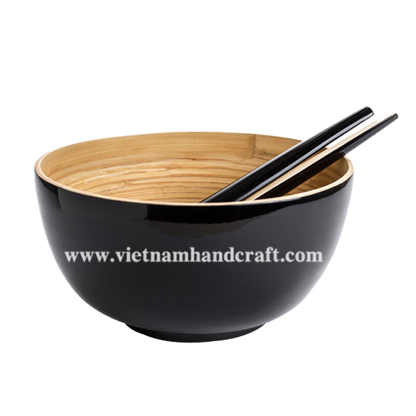 Lacquered bamboo salad bowl with salad server set. Inside in natural bamboo, outside in black