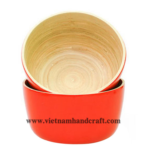 Lacquered bamboo food bowl. Inside in natural bamboo, outside in orange