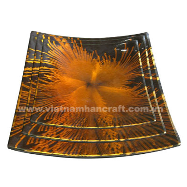 Set of three black lacquered plates with hand-painted orange fireworks