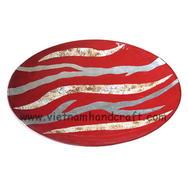 Red lacquer plate with motifs in burnt eggshell and white silver leaf