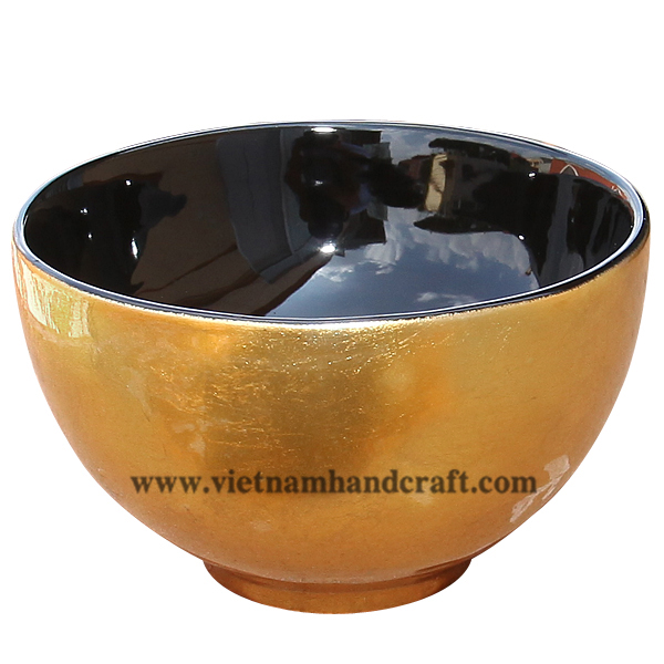 Lacquer bowl. Inside in black, outside in gold leaf