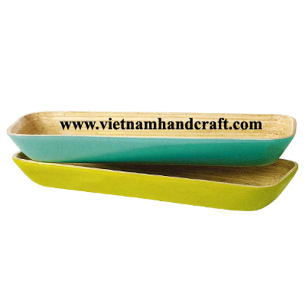 Lacquered bamboo food bowls. Inside in natural bamboo, outside in various solid colors