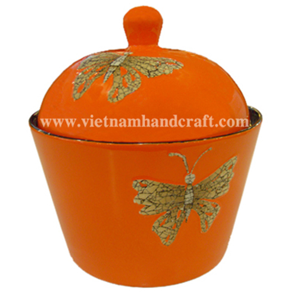 Lacquered storage bowl with lid. Inside in black, outside in solid orange with eggshell butterflies inlay