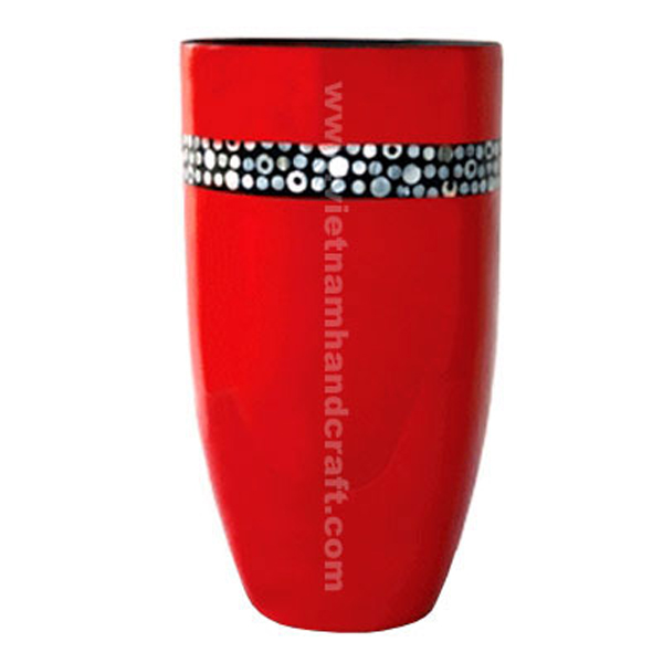 Red lacquered vase inlaid with mother of pearl on black background