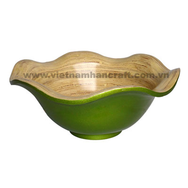 Lotus leaf shaped lacquer bamboo bowl. Inside in natural bamboo, outside in solid metallic green