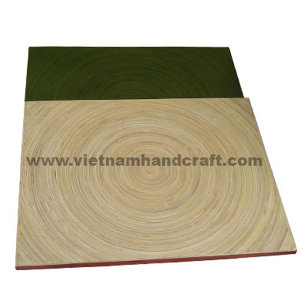 Set of 2 coiled bamboo placemats. Top in natural, bottom hand lacquered in green