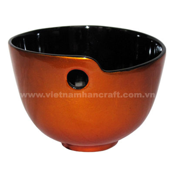 Lacquered serving bowl. Inside in black, outside in gold silver leaf