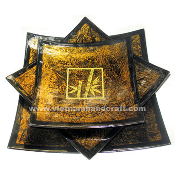 Lacquerware decoration plate. Inside in silver metallic orange on black background and with hand-painted gold bamboo treess