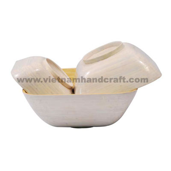 Set of 3 coiled bamboo fruit bowls. Inside in natural, outside hand-painted in white