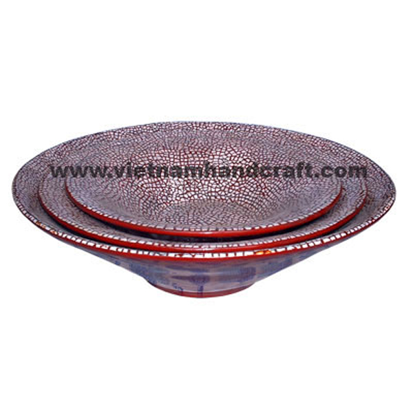 Red lacquered decorative bowl with white eggshell inlay inside