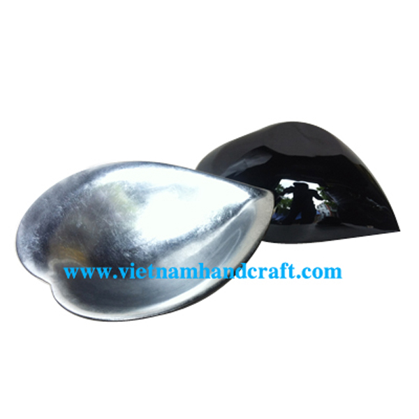 heart shaped lacquered bowl. Inside in silver leaf, outside in black