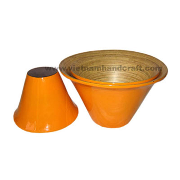 Lacquered bamboo storage bowl. Inside in natural bamboo, outside in solid orange