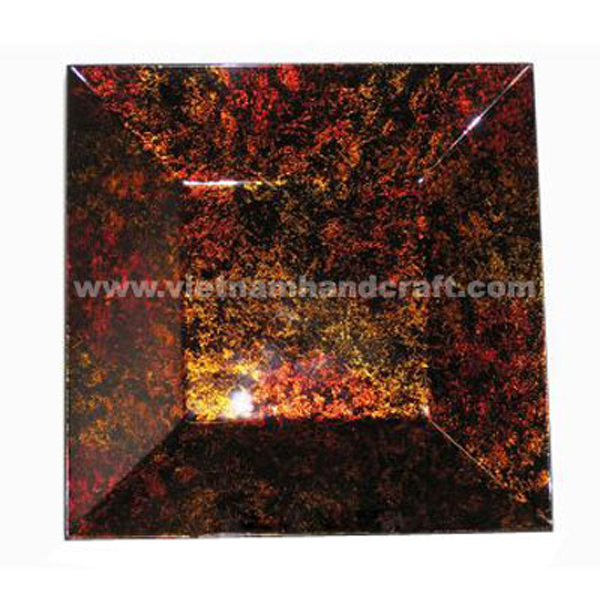 Lacquer decoration plate in silver metallic red & gold on black background