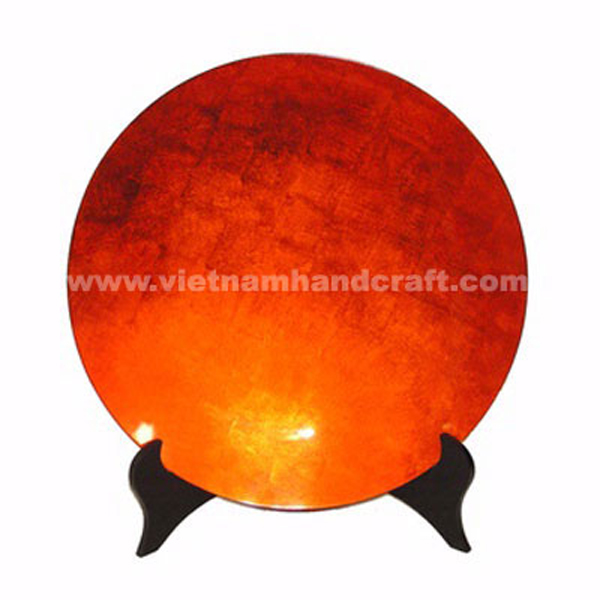 Orange silver lacquered decoration plate on a black stand