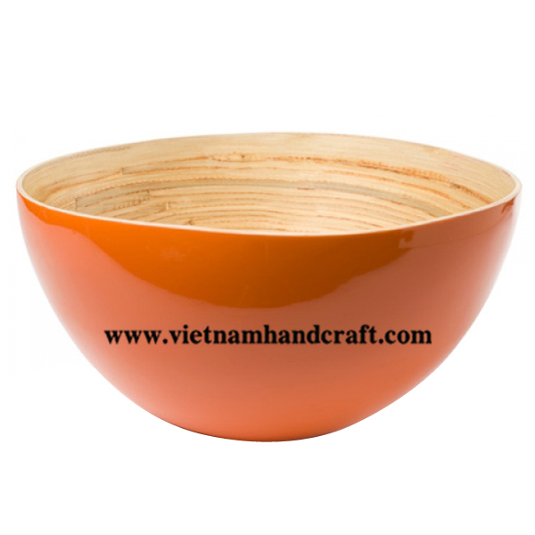 Lacquered serving bowl. Inside in natural bamboo, outside in solid orange