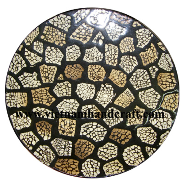 Black lacquer plate inlaid with burnt eggshell