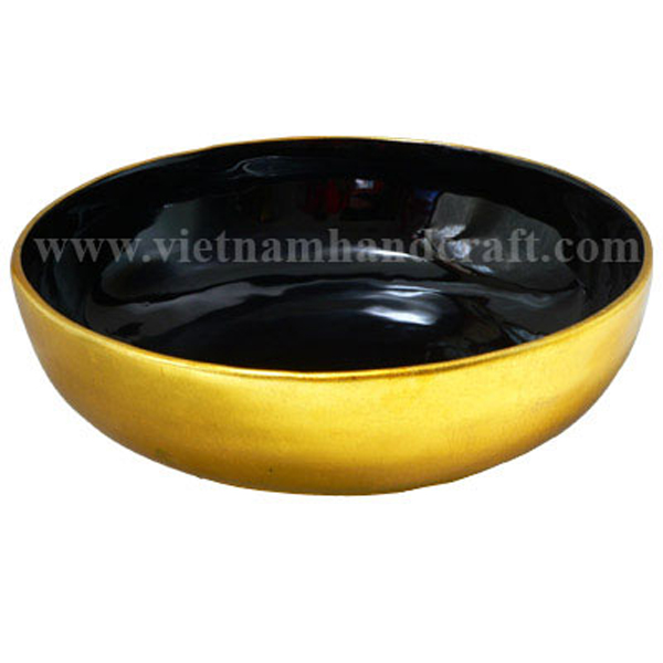 Lacquered food bowl. Inside in black, outside in gold silver leaf