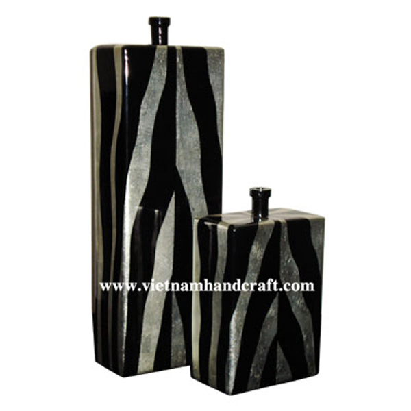 Black lacquered vase with hand-painted white silver motifs