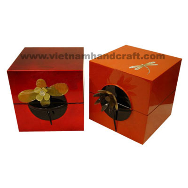 Set of 2 lacquered wood jewellery boxes. One in red silver, the other in solid orange with eggshell dragonfly. All with buffalo horn pin