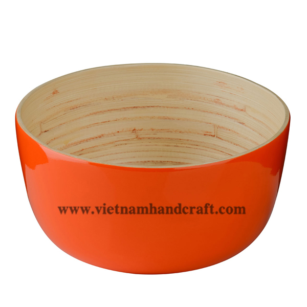 Lacquered bamboo decor bowl. Inside in natural bamboo, outside in solid orange