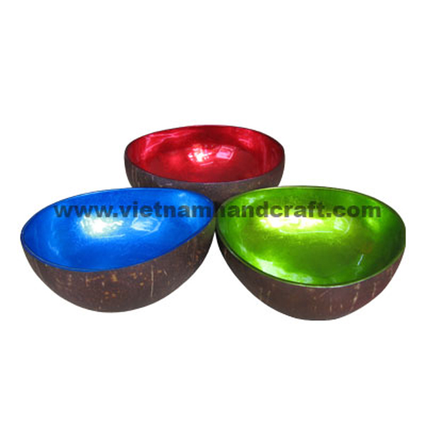 Lacquered coconut bowl. Inside in silver metallic red, blue & green, outside in natural coconut shell