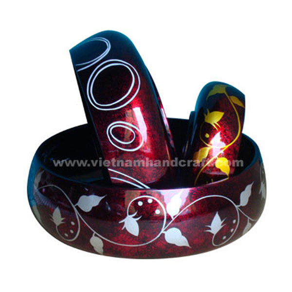 Lacquer decorative bowl. Inside in black, outside in silver metallic red on black background and with hand-painted motifs