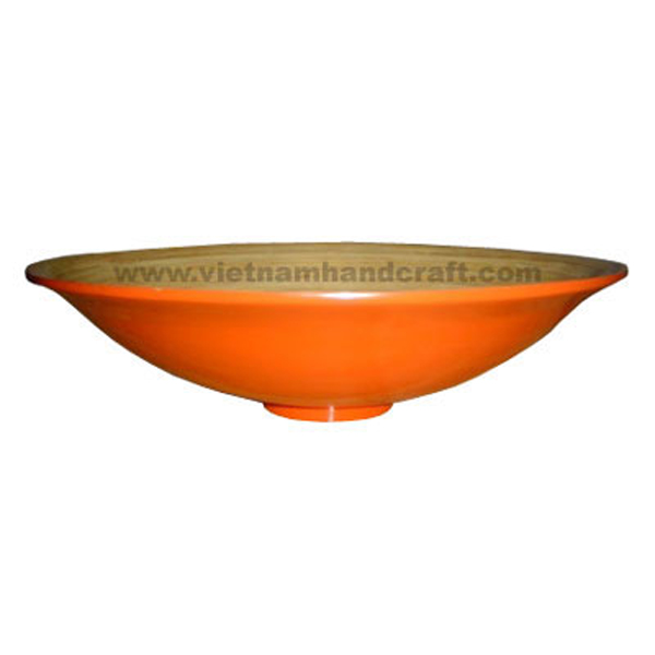 Lacquered bamboo decor bowl. Inside in natural bamboo, outside in orange