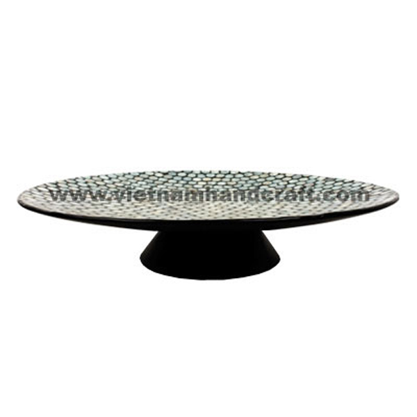 Black lacquered plate inlaid with round pieces of seashell