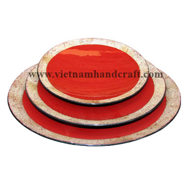 Set of three red & black lacquerware plates with eggshell inlay