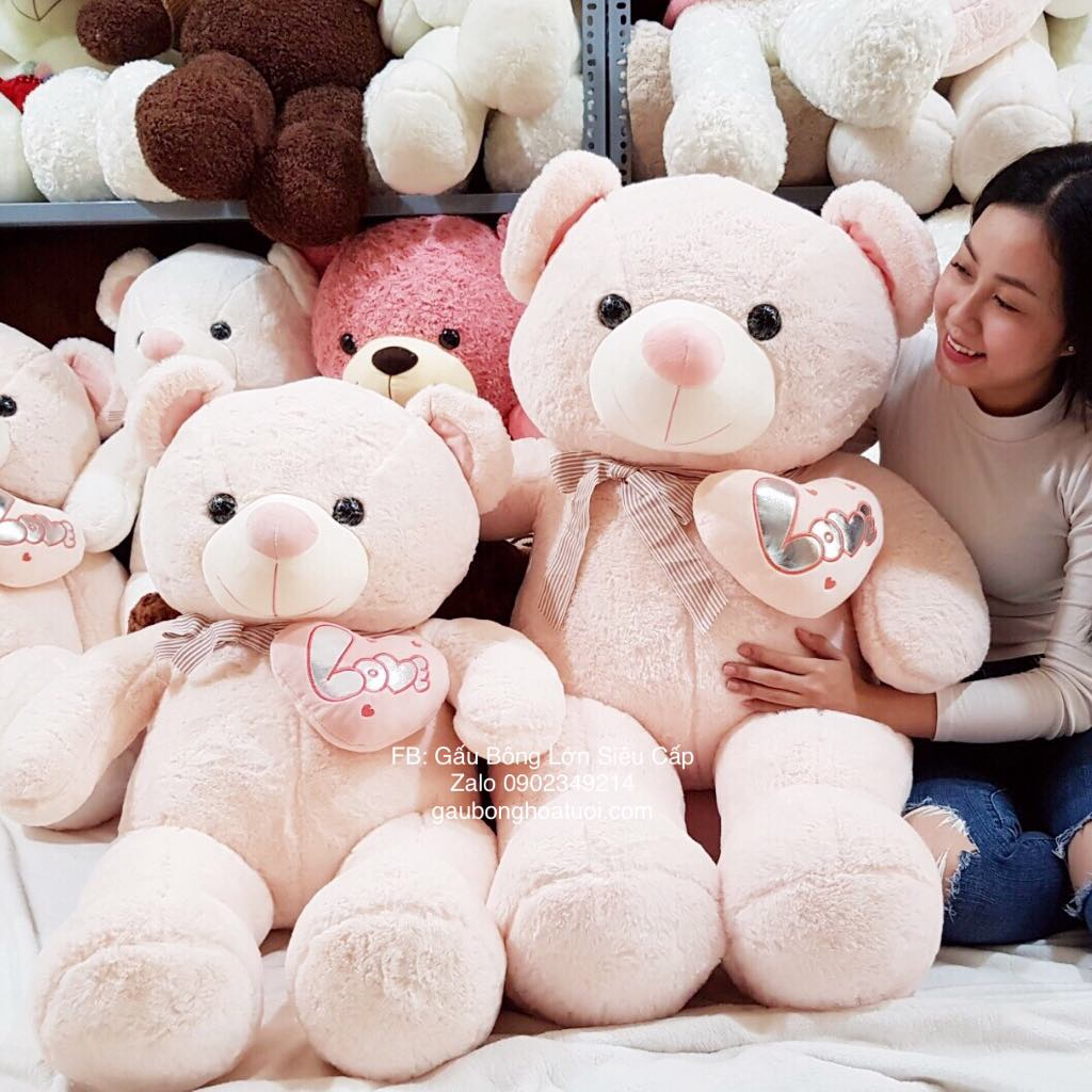 Gấu bông ôm tim hồng khổ 1m5