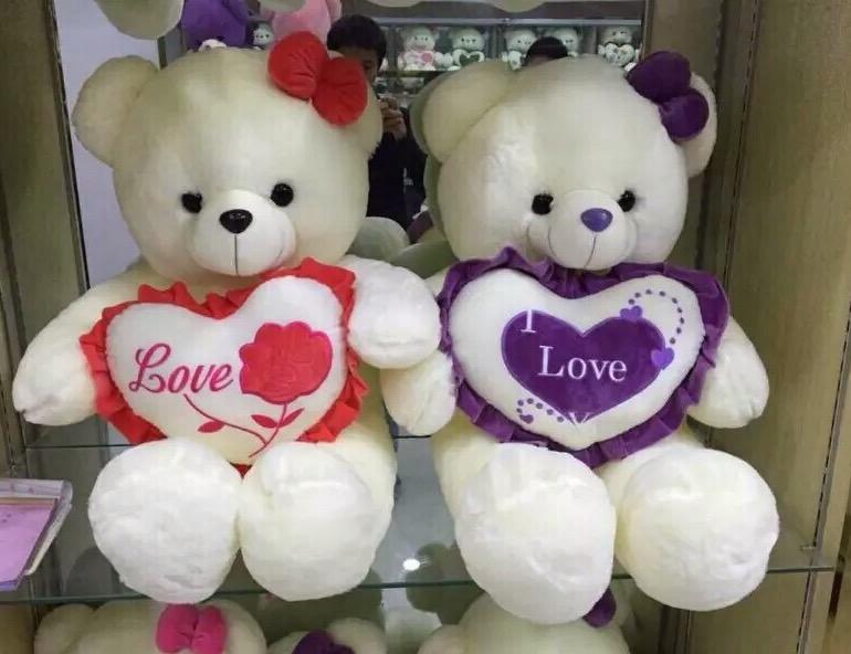 Gấu nhồi bông ôm tim tím hoa hồng 1m4