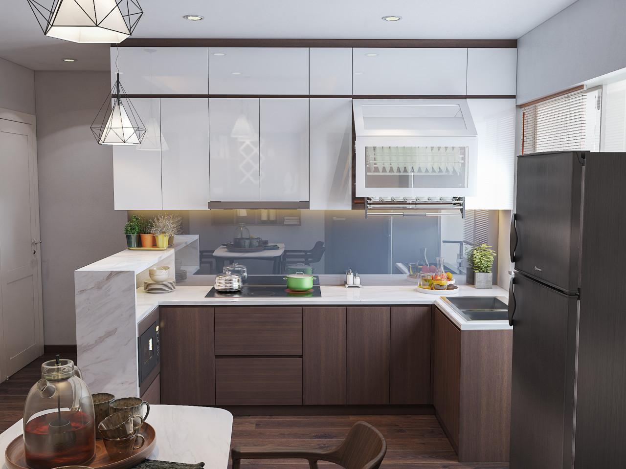 Tủ bếp được thiết kế với chất liệu acrylic tráng gương kết hợp với tông nâu gỗ mang lại cảm giác sạch sẽ và sang trọng