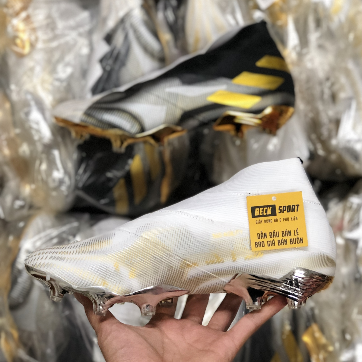 Giày Bóng Đá Adidas Nemeziz 19+ Đen Trắng Vạch Vàng Không Dây Cổ Cao FG