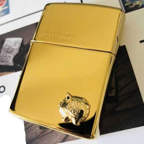 bán Zippo 18k mạ vàng mẫu heo hay mèo Nhật