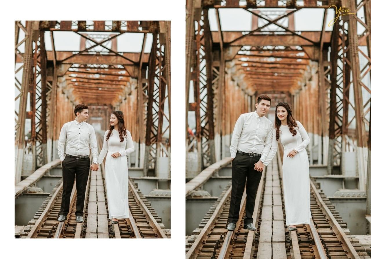 ảnh cưới pre wedding cô dâu chú rể nắm tay đi trên đường ray cầu long biên