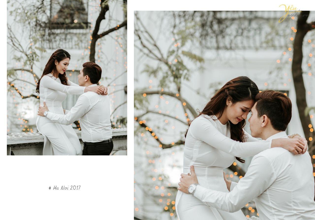 ảnh cưới áo dài cô dâu ngồi trên thành cầu chú rể ôm eo