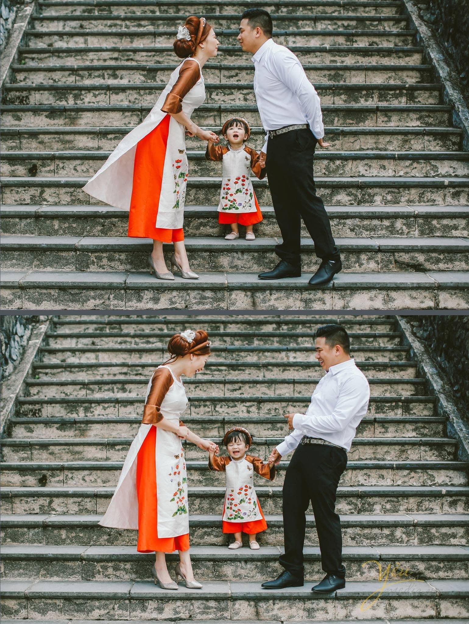 ba mẹ dắt tay con gái trên bậc thềm