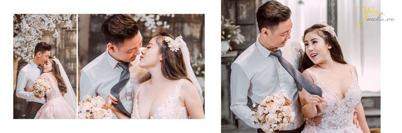 chú rể hôn nhẹ lên trán cô dâu