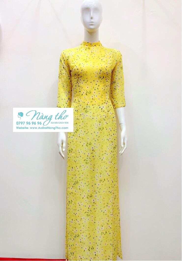 Áo dài lụa hoa nhí màu vàng