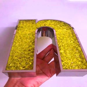 Chữ Inox mặt Acrylic  giả đá màu vàng nắng